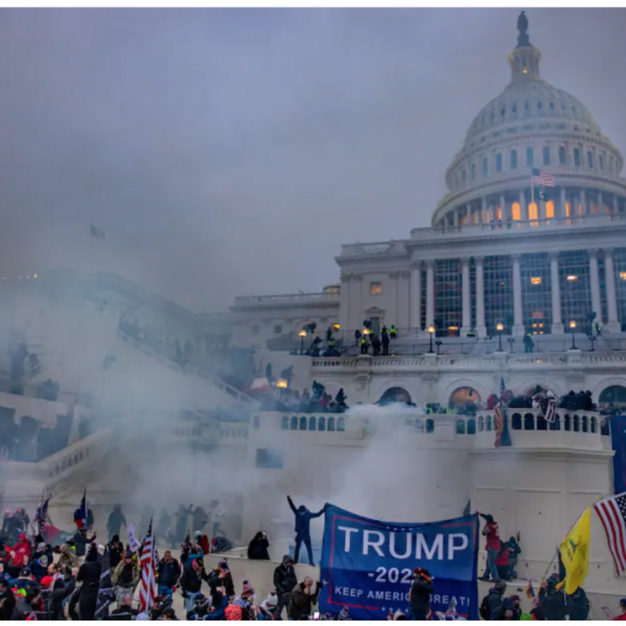 Tear gas is fired at rioters storming the U.S. Capitol. (Evelyn Hockstein/The Washington Post)
